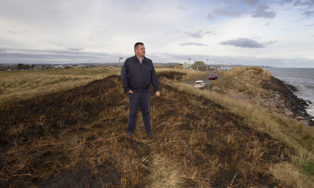 Mark Salmond at the grass area burnt along the seafront at Montrose.