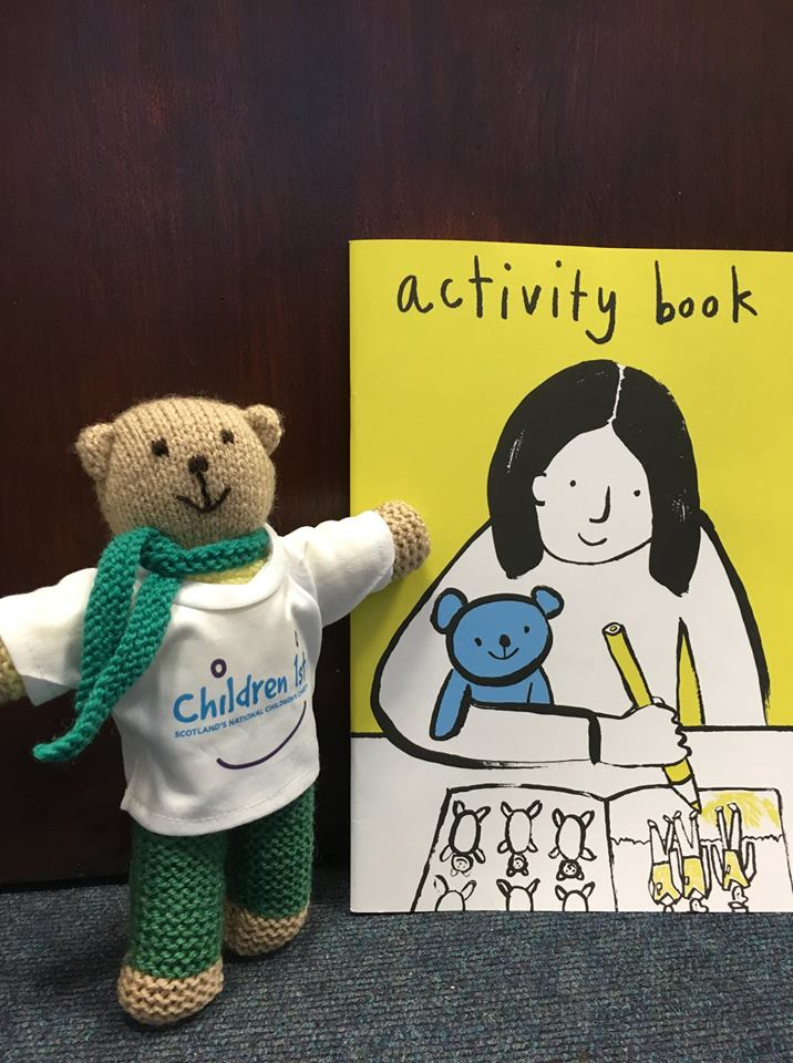 An image showing the comfort teddy and activity book.