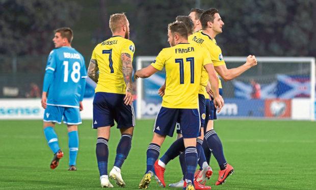 Scotland's Kenny McLean (far right) celebrates scoring his side's first goal of the game with team-mates during the UEFA Euro 2020 Qualifying, Group I match at the San Marino Stadium, Serravalle.