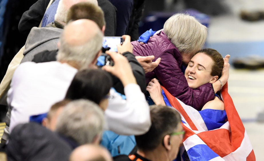 Great Britain's Laura Muir celebrates winning gold in the Women's 3000m final during day one of the European Indoor Athletics Championships at the Emirates Arena, Glasgow