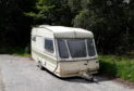 Tents, chopped down fences and even abandoned caravans have been left at Loch Tummel by wild campers