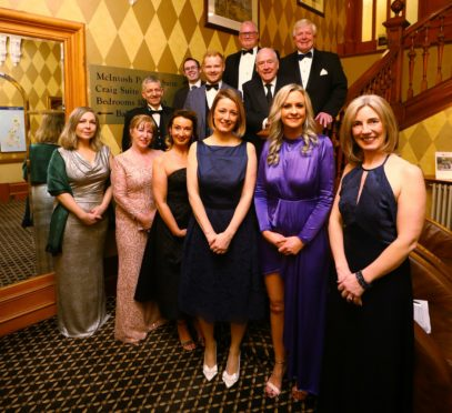 Courier News - Dundee story ARCHIE Spring Ball. CR0007113 Picture shows; the organising committee at the ARCHIE Spring Ball, at the Invercarse Hotel in Dundee tonight, with Cassie Thompson - Director of Partnerships at ARCHIE 3rd from right, Sarah Johnston - Fundraising Manager ARCHIE 2nd from right, Ian Philp - Chairman of the Fundraising Committee back right, and guest speaker Andy Cameron (in front of Ian Philip). Friday 15th March 2019. Dougie Nicolson / DCT Media.