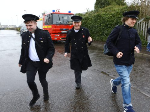 Connor McDade, Alan Duncan and Levon Anderson, who were raising money for Dundee Junior Showtime, with the 1995 Dennis fire engine, in Laurencekirk