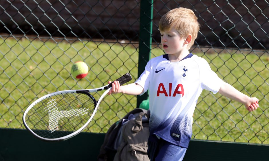 Big Tennis Weekend at Dawson park Dundee for all ages, 4 year old Ruairidh Logan in action.