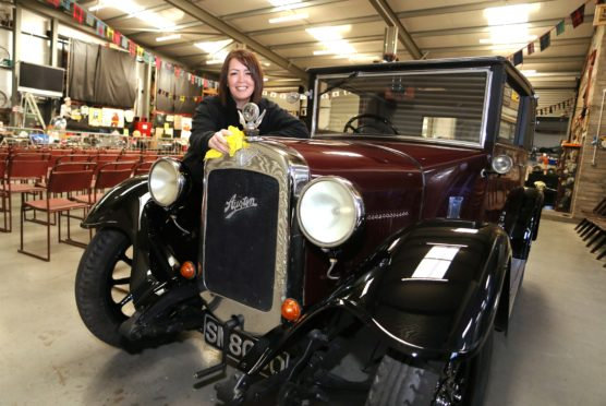 SVVC administrator Lesley Munro gives an 1930 Austin 12 a final polish ahead of the weekend auction