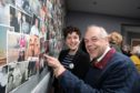 Crickety hub trustees Steve Dempsey and Mairi Gougeon MSP at the photo feature wall