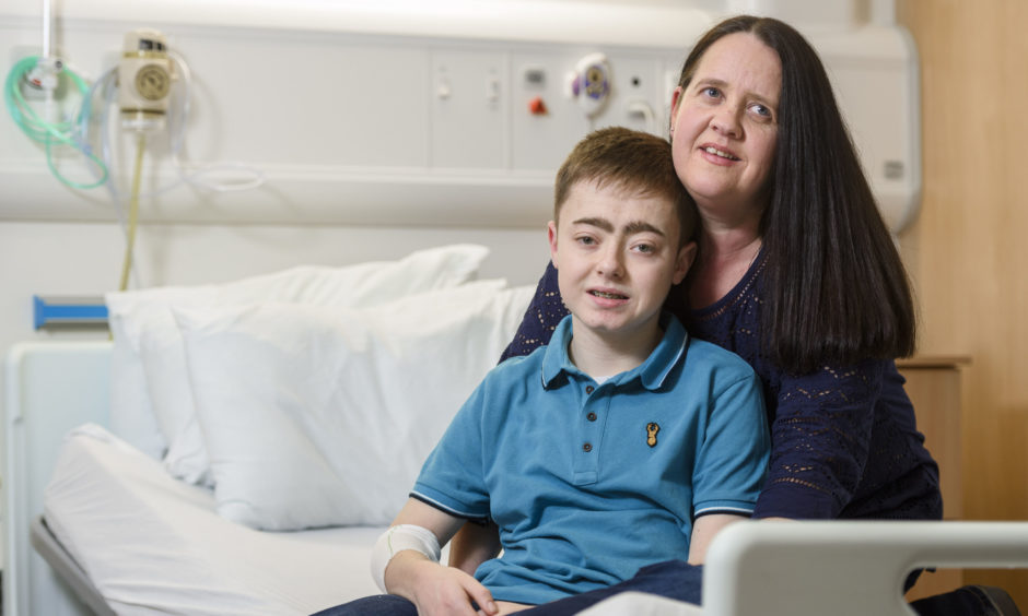 Cheryl Gallacher, 44, with her son Stephen Gallacher, 15, from Musselburgh in East Lothian, as she prepares to be a live kidney donor for her son, at the Royal Hospital for Children in Glasgow. The 15-year-old has become the 100th child in Scotland to receive a kidney transplant from a living donor. Stephen  received the organ from his mother Cheryl in a transplant operation lasting just over four hours at Glasgow's Royal Hospital for Children on Wednesday.