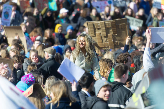 Young people taking part in a Climate Strike outside the Scottish Parliament.
