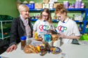 Brechin Pantry chairperson Kathy Calderwood wirh Mearns Academy S3 pupils Iris Calderwood and Erin Hair