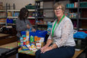 Joyce Leggatte, chairman of the foodbank with a typical three day emergency food parcel for a single person.