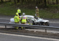 Police, Firefighters and Paramedics at work on the M90 motorway