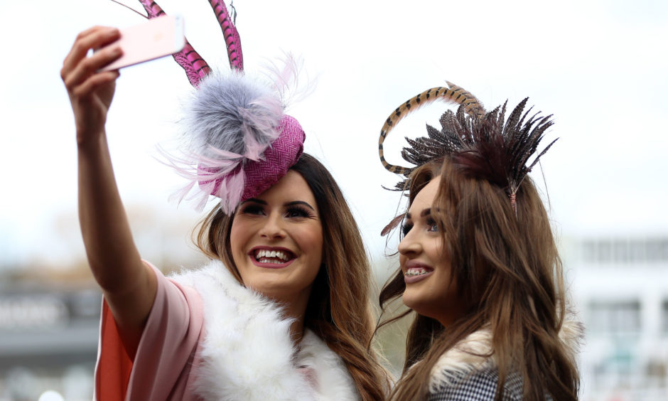 Amy Brown and Jessica Carpenter stop for a selfie. Nigel French/PA
