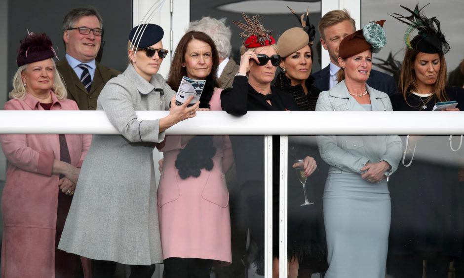 Zara Tindall (2nd left) and Dolly Maude (2nd right) during St Patrick's Thursday of the 2019 Cheltenham Festival at Cheltenham Racecourse.