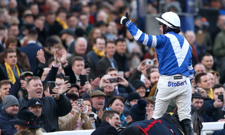 Bryony Frost on board Frodon celebrates victory in the Ryanair Chase during St Patrick's Thursday.