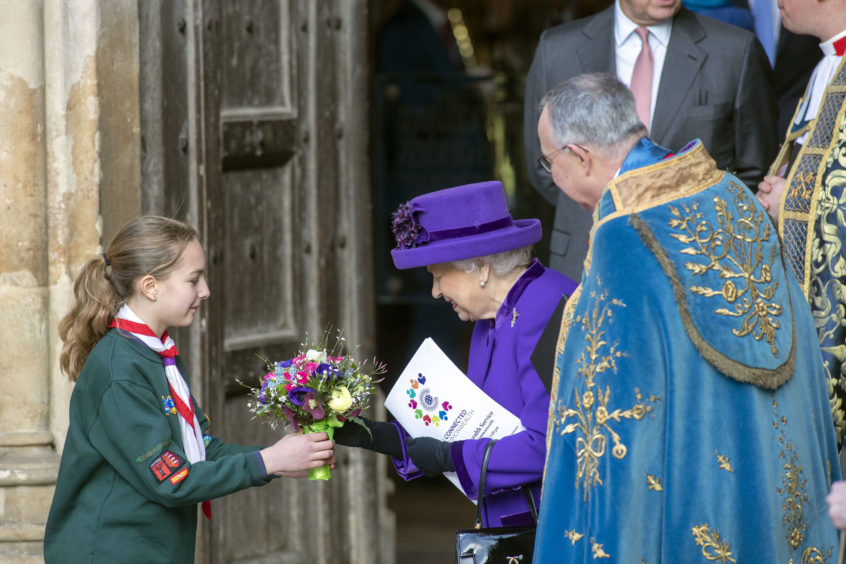 Queen Elizabeth II leaves following the Commonwealth Service at Westminster Abbey, London.