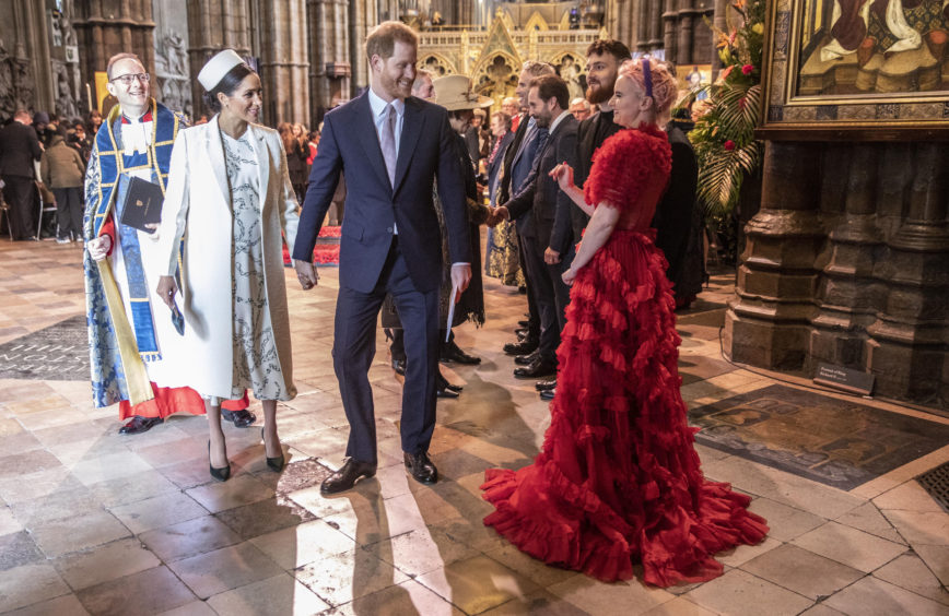 """The Duke and Duchess of Sussex talk with Grace Chatto from the group """"Clean Bandit"""" who performed at Westminster Abbey Commonwealth day service, London."""