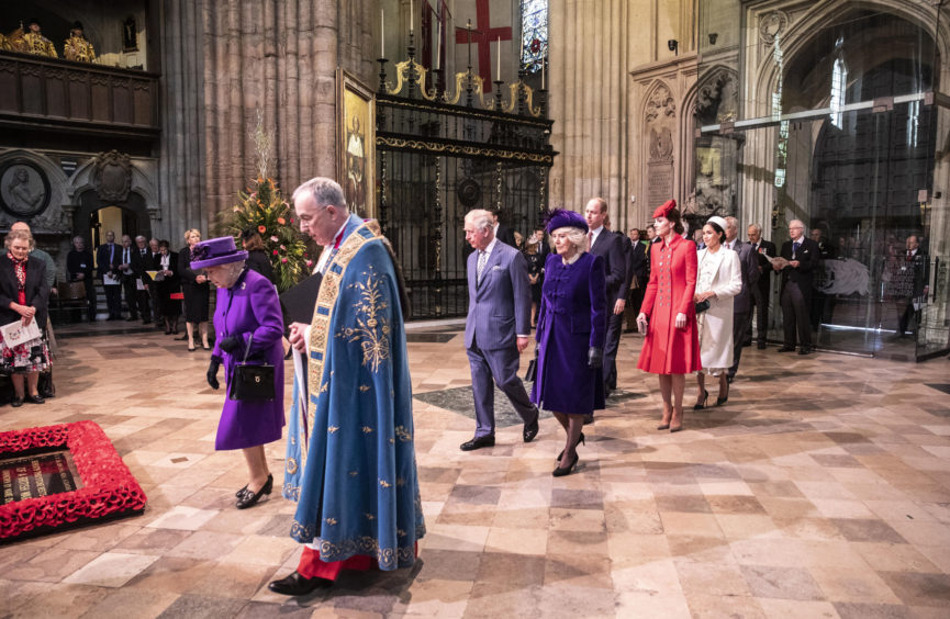 Queen Elizabeth II leads the Royal family in procession at the Commonwealth Service at Westminster Abbey London