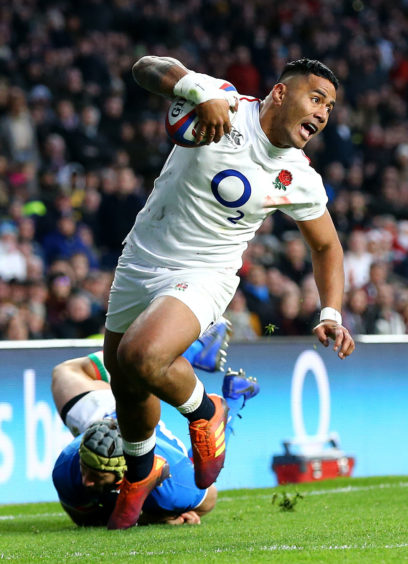 England's Manu Tuilagi scores his side's fifth try during the Guinness Six Nations match at Twickenham Stadium, London.