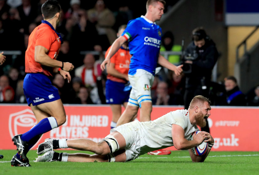 England's Brad Shields scores his team's eighth try during the Guinness Six Nations match at Twickenham Stadium, London.