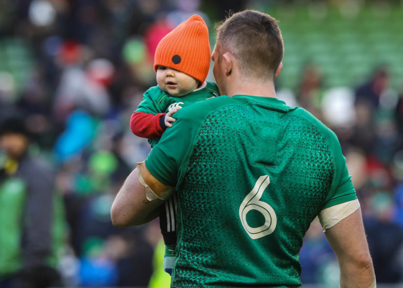 Ireland's Peter O'Mahony and his son Theo after the Guinness Six Nations match at the Aviva Stadium, Dublin..
