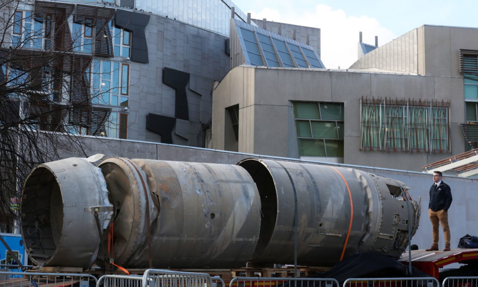 Owain Hughes views the Black Arrow rocket outside the Scottish Parliament. It was brought home from the Australian outback by Scottish space firm, Skyrora, and was the only UK rocket to reach orbit.