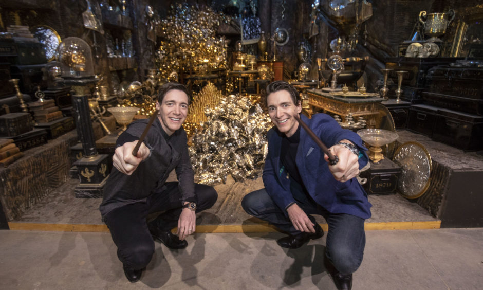 James Phelps and Oliver Phelps in front of the Lestrange Vault set at the opening of the new Gringotts Wizarding Bank expansion at the Making Of Harry Potter attraction at the Warner Bros Studio Tour, in Watford.