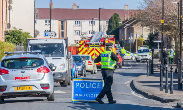 Police at the scene in the Douglas area of Dundee.