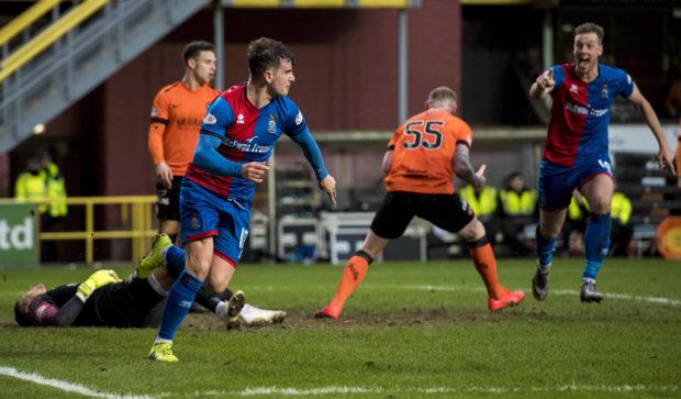 Aaron Doran, left, turns away to celebrate scoring the winner for Inverness.