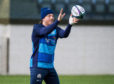 Hamish Watson returns to Scotland training.