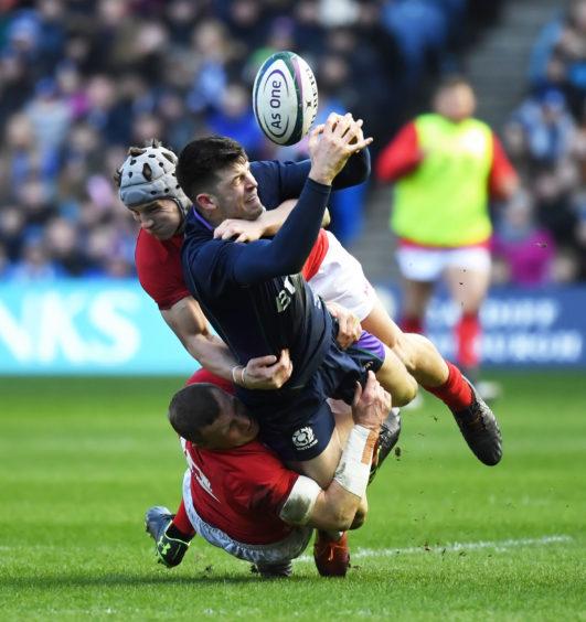 UINNESS SIX NATIONS SCOTLAND v WALES (11-18) BT MURRAYFIELD STADIUM - EDINBURGH Scotland's Blair Kinghorn breaks through a crowd of bodies