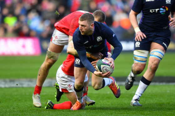 Finn Russell in action for Scotland against Wales.