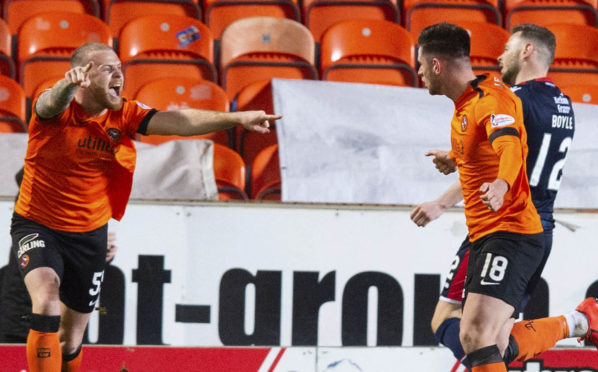Dundee United's Mark Connolly celebrates with the goalscorer, Calum Butcher, after giving his side the lead.