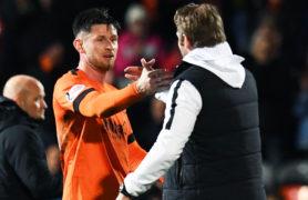 Dundee United manager Robbie Neilson congratulates matchwinner Calum Butcher at full-time.