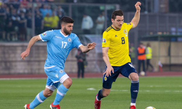 Scotland's Kenny McLean (right) skips away from San Marino's Enrico Golinucci.
