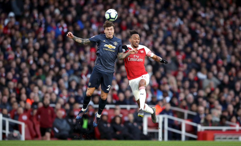 Manchester United's Victor Lindelof (left) and Arsenal's Pierre-Emerick Aubameyang battle for the ball during the Premier League match at the Emirates Stadium, London.