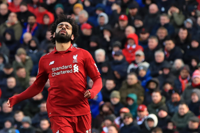 Liverpool's Mohamed Salah reacts during the Premier League match at Anfield,
