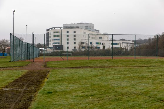 The hospital overlooks the park but there is no through route