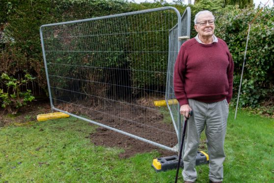 Mr Holmes in the fenced off polluted area of his garden
