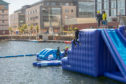 Thrill seekers at the aqua park at City Quay