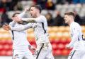 Dundee United celebrate Nicky Clark's equaliser.