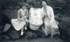 Anne Edmond in the crib with her mother (also called Anne) and cousin May Johnstone (although her surname was Tennant at the time of the photo).