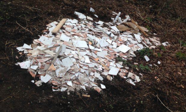 Broken tiles dumped in Balgay Park in Dundee.