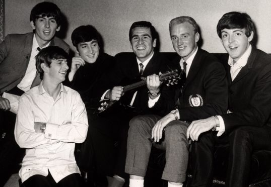 THe Beatles meet Dundee FC players Hugh Robertson and George Ryden on their 1963 visit to Dundee.
