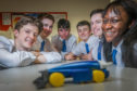 From left: Zac Brownlow, Logan Cosgrove, Matthew Begg, Ben Birtwistle, Matthew Ritchie and Emmanuella Damptey with their F1 car.