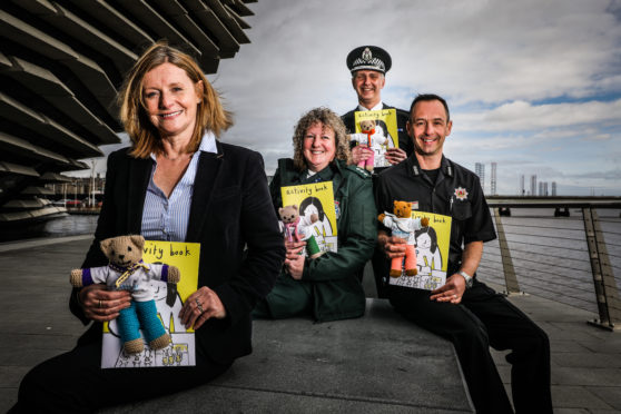 Picture shows; Linda Jardine, Director of Children and Family Services with Children 1st, Carla Donnachie, Scottish Ambulance Service, Superintendent Shaun McKillop and Steven Low, Scottish Fire and Rescue Service.