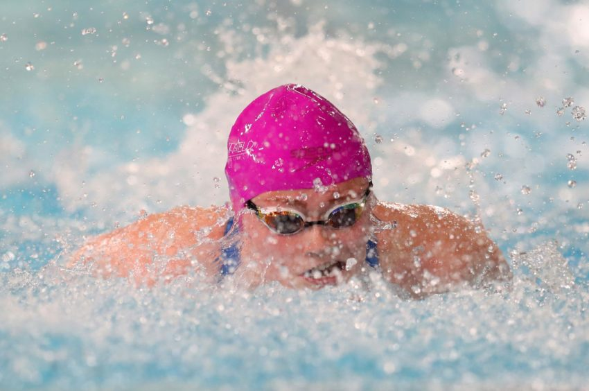 Jessica Woodward competes in the Women's 50m Butterfly heats.