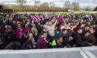 The Arbroath fans celebrate on the pitch at full-time.