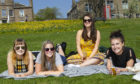Students Emma Gilmour, Aimee Corcoran, Amy Clelland and Gaby Black out sunbathing in Dundee Pic Paul Reid