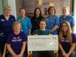 The Fenton family present the cheque
