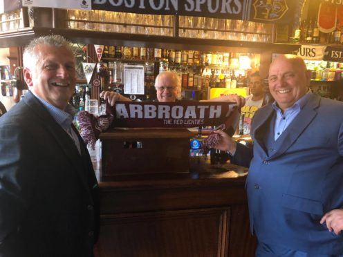 Mike, left, and Dick, right, nail their colours to the mast in the stadium bar before the match